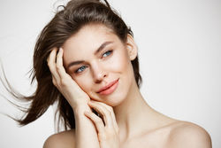 stock-photo-beautiful-naked-young-girl-with-perfect-clean-skin-smiling-touching-hair-over-white-wall-facial-670525174.jpg