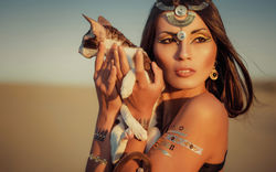 stock-photo-glamorous-portrait-of-beautiful-sexy-brunette-woman-model-with-flash-tattoo-cleopatra-shooting-455958127.jpg