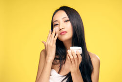 stock-photo-korean-woman-with-face-cream-642030997.jpg