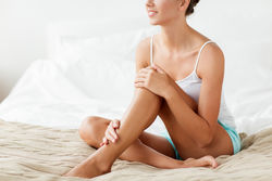 stock-photo-people-beauty-depilation-epilation-and-bodycare-concept-beautiful-woman-with-bare-legs-sitting-632997599