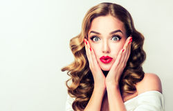 stock-photo-woman-surprise-holds-cheeks-by-hand-beautiful-girl-with-curly-hair-pointing-to-looking-right-515004724.jpg