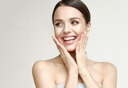 stock-photo-happy-beautiful-girl-holding-her-cheeks-with-a-laugh-looking-to-the-side-expressive-facial-748987114.jpg
