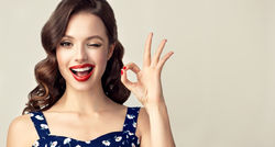stock-photo-pin-up-retro-girl-with-curly-hair-winking-smiling-and-showing-ok-sign-presenting-your-product-753493738.jpg