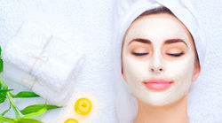 stock-photo-spa-woman-applying-facial-clay-mask-beauty-treatments-close-up-portrait-of-beautiful-girl-with-a-625937531.jpg