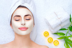 stock-photo-spa-woman-applying-facial-clay-mask-beauty-treatments-close-up-portrait-of-beautiful-girl-with-a-626152427.jpg